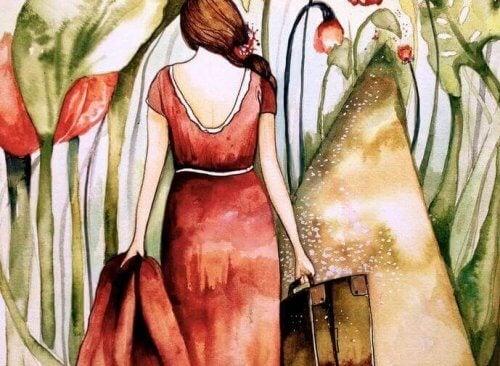 donna di spalle con valigie
