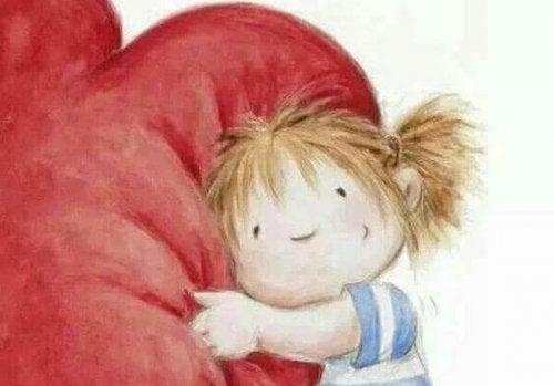 bambino che abbraccia un cuore