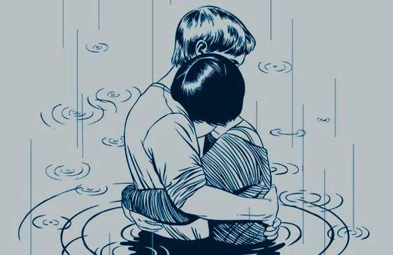 coppia-che-si-abbraccia-sotto-la-pioggia