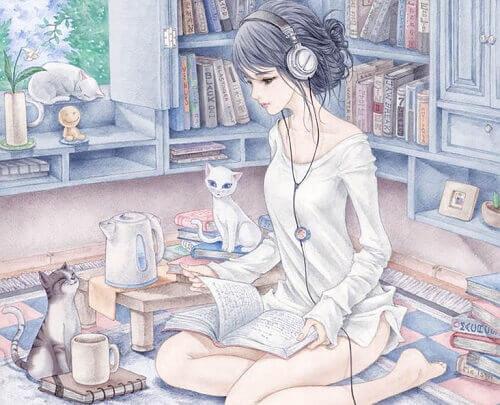 ragazza-che-studia-circondata-da-gatti