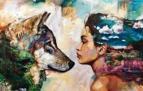 donna e lupo che si guardano