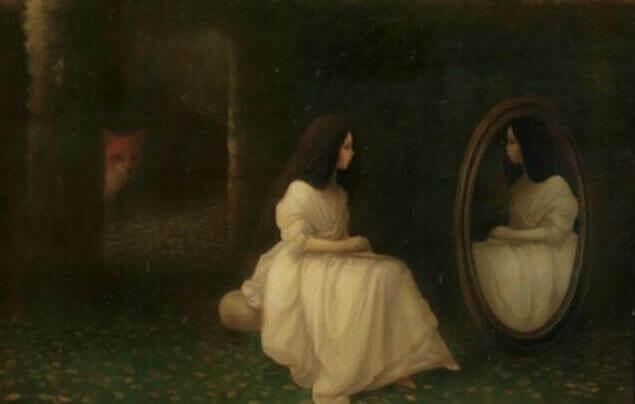 donna-che-si-guarda-allo-specchio