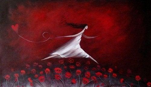donna-campo-fiori-rossi