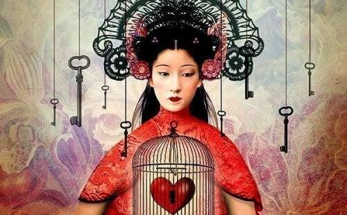 ragazza-asiatica-con-cuore-in-gabbia