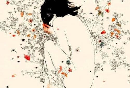 ragazza-ranicchiata-tra-i-fiori