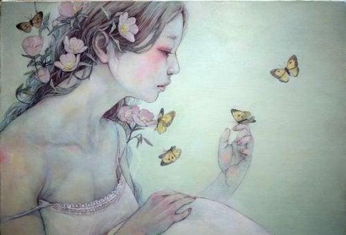 ragazza-con-fiori-in-testa-e-farfalle-intorno