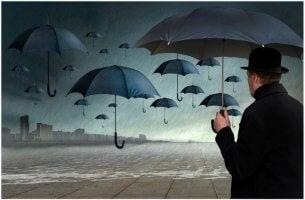 persona insicura uomo-con-ombrelli-e-ombrelli-che-fluttuano