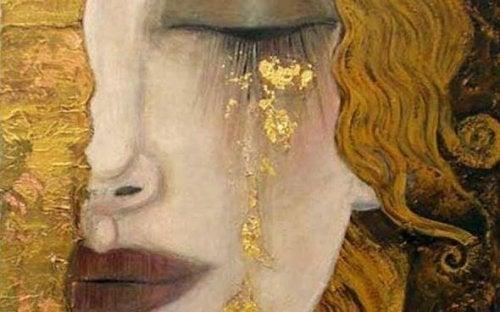 Donna che piange lacrime d'oro
