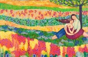 Coppia in un campo di fiori che si insegnano cose belle della vita
