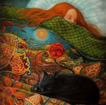 Ragazza che dorme in con il suo gatto