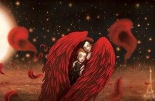 Coppia avvolta dalle ali rosse della chimica dell'amore