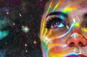 Donna con colori sul viso a cui piace la sua vita