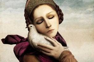 Donna con una colomba che cerca la felicità