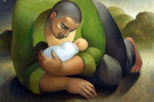 Padre che tiene in braccio il figlio
