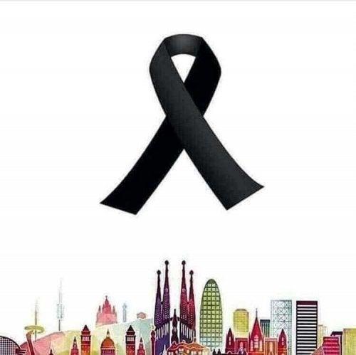 Simbolo di lutto sopra alla skyline di Barcellona