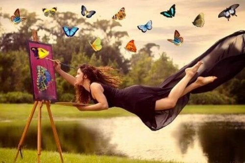 Donna che dipinge volando e farfalle