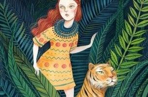 Ragazza e tigre con un atteggiamento forte