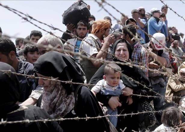 Rifugiati dietro un filo spinato
