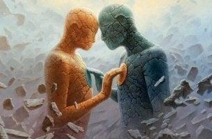 Sagome di pietra che si toccano a vicenda il petto in rappresentazione della psicologia della connessione