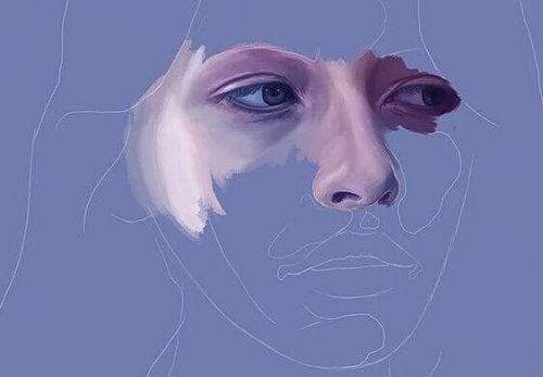 Volto femminile con occhi tristi