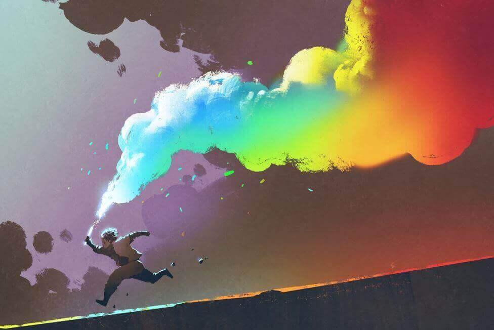 Bambino con fumogeni colorati