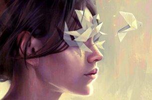 Donna con origami sugli occhi in cerca di tecniche per gestire le emozioni