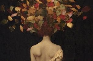 Donna con foglie in testa che vuole liberarsi dalla tristezza
