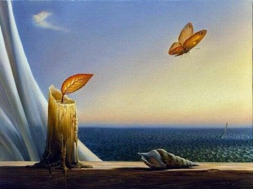 Farfalla che vola e una candela, rappresentando l'ispirazione per scrivere frasi per ricominciare