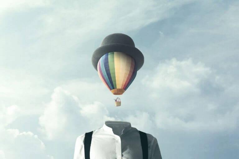 Uomo con mongolfiera a posto della testa