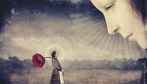 Volto che osserva una bambina con un fiore gigante