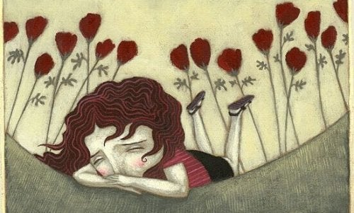Bambina triste circondata da fiori