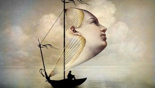Barca con una vela a forma di faccia