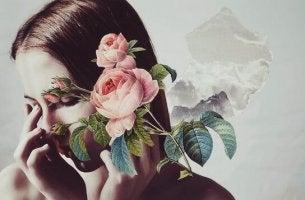 Donna con fiori davanti al volto eccesso di empatia