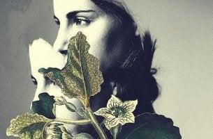Donna triste con foglie e fiori superare una delusione amorosa