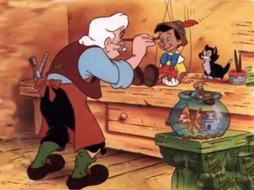 Geppetto che dipinge Pinocchio