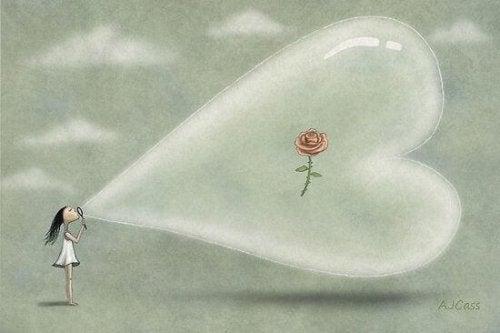 Bambina con bolla a forma di cuore con dentro un fiore