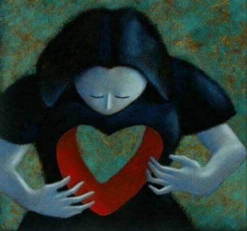 Donna con un buco a forma di cuore, in rappresentazione dei nostri vuoti