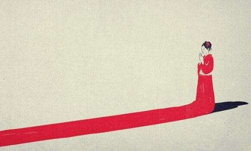 Donna giapponese vestita di rosso, rappresentazione della psicologia giapponese