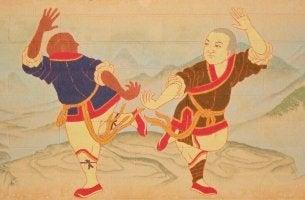 Pittura di due persone che praticano arti marziali