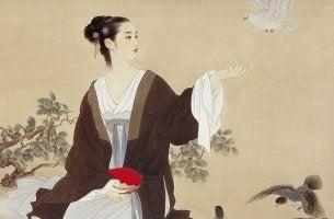 Ragazza cinese con una colomba bianca gestire le persone difficili
