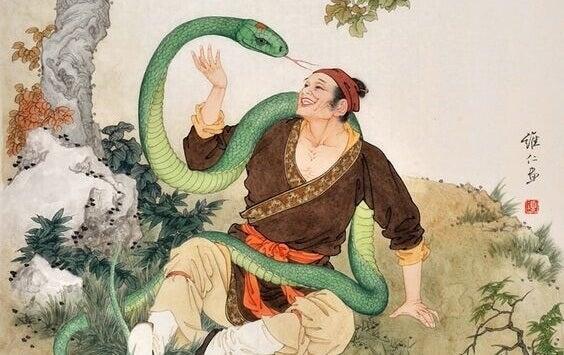 Uomo avvolto da un serpente