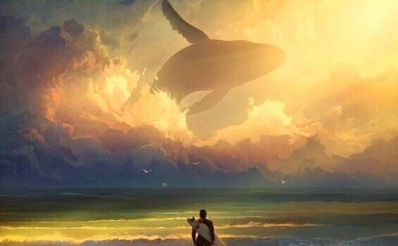 Surfista e balena nel cielo