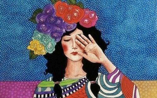 Donna che si copre un occhio