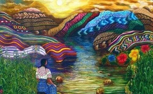 Donna in mezzo a delle montagne ricche di colori