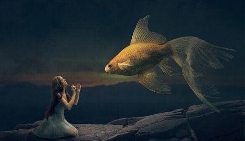ragazza con un pesce