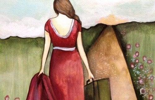 Donna di spalle con valigia