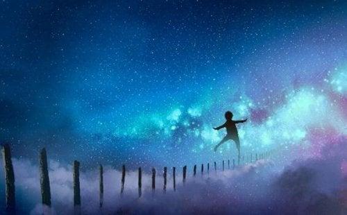 Ragazzo in un cielo stellato che attraversa una barriera
