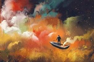 Uomo su una barca in mezzo alle nuvole