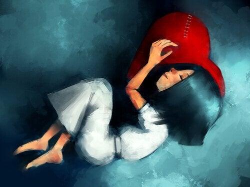 Bambina che dorme su un cuore ricucito persone terapeutiche