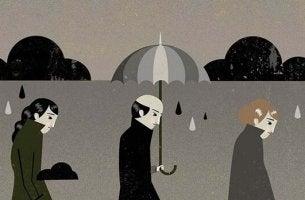 Persone con ombrelli sotto la pioggia sintomi della depressione